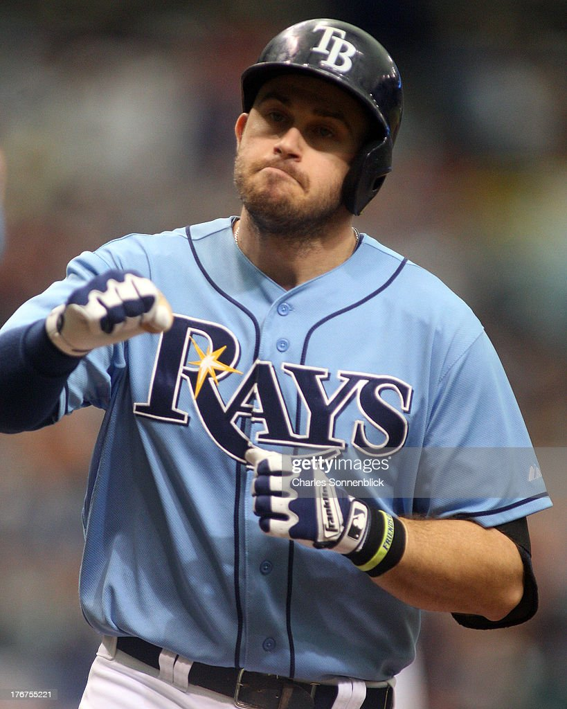 Evan Longoria #3 of the Tampa Bay Rays steps on home plate after hitting a solo homerun in the first inning against the Toronto Blue Jays during the game on August 18, 2013 at Tropicana Field in St. Petersburg, Florida.