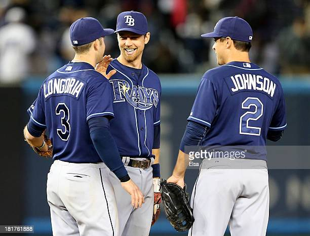 Evan LongoriaBen Zobrist and Kelly Johnson of the Tampa Bay Rays celebrate the win over the New York Yankees on September 24 2013 at Yankee Stadium...