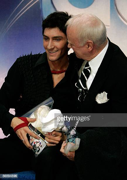 Evan Lysacek and his coach Frank Carroll react after receiving his scores in the Free program during the 2006 State Farm U.S. Figure Championships at...