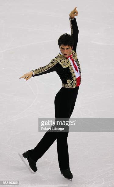 Evan Lysacek of the United States competes in the Men's Short Program Figure Skating during Day 4 of the Turin 2006 Winter Olympic Games on February...