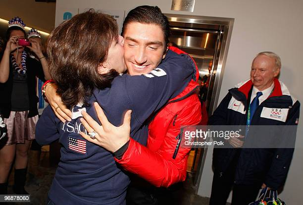 Evan Lysacek of the United States is greeted by his mother Tanya at the USA House after winning the men's figure skating Olympic gold medal on...