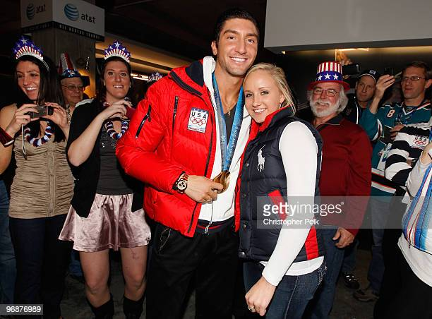 Evan Lysacek of the United States shares his men's figure skating Olympic gold medal with US gymnast Nastia Liukin at the USA House on February 18...
