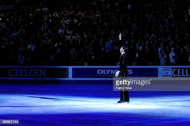 Evan Lysacek of the United States skates out to receive his gold medal following the Men's Free Skate during the 2009 ISU World Figure Skating...