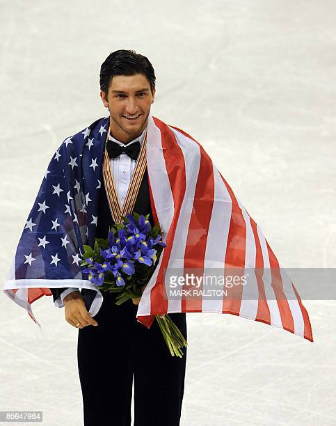 Evan Lysacek of the US poses with his gold medal after the Men Free Skating event of the 2009 World Figure skating Championships at the Staples...