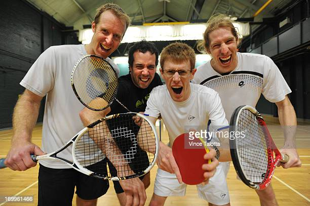 Evan Mancer from Winnipeg holding a squash racket Frederic D'amours from Quebec holding a badminton racket Calum Reid from Scotland holding a table...