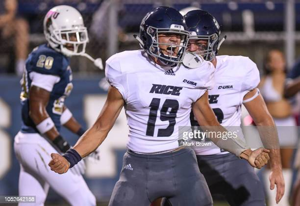 Evan Marshman of the Rice Owls reacts to scoring a touchdown in the first half against the FIU Golden Panthers at Ricardo Silva Stadium on October 20...