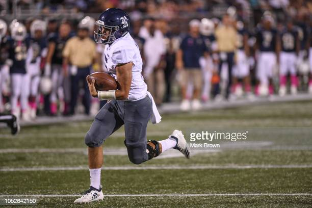 Evan Marshman of the Rice Owls scores a touchdown in the first half against the FIU Golden Panthers at Ricardo Silva Stadium on October 20 2018 in...