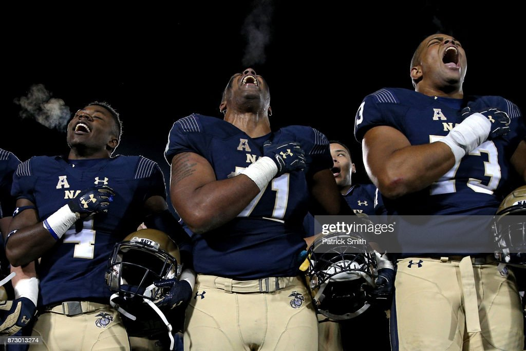 Evan Martin #71 of the Navy Midshipmen and teammates celebrate after defeating Southern Methodist Mustangs, 43-40, at Navy-Marines Memorial Stadium on November 11, 2017 in Annapolis, Maryland.