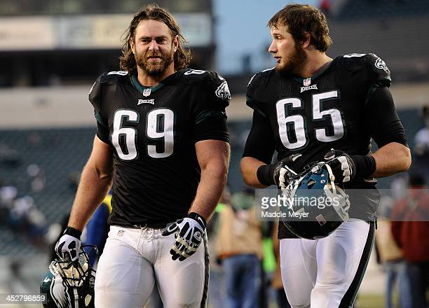 Evan Mathis of the Philadelphia Eagles and Lane Johnson walk off of the field following the game against the Arizona Cardinals at Lincoln Financial...