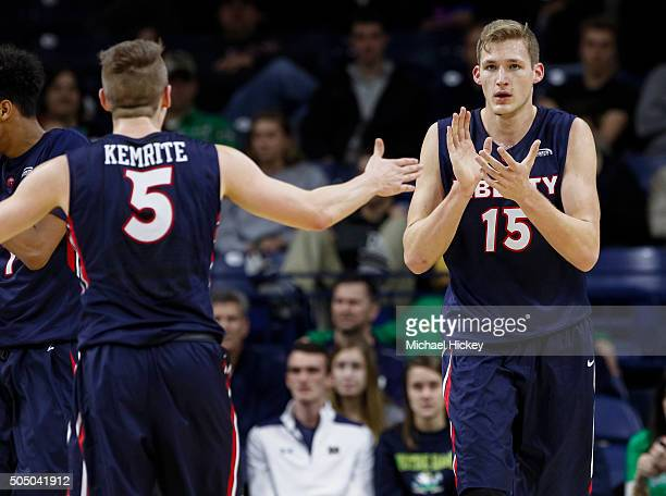 Evan Maxwell and Ryan Kemrite of the Liberty Flames celebrate during the game against the Notre Dame Fighting Irish at Purcell Pavilion on December...
