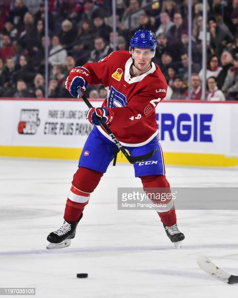 Evan McEneny of the Laval Rocket plays the puck against the Toronto Marlies during the second period at Place Bell on December 28 2019 in Laval...