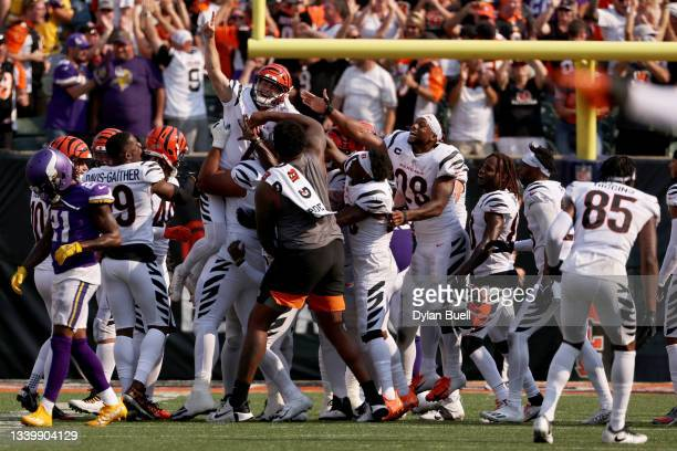 Evan McPherson of the Cincinnati Bengals celebrates with teammates after kicking a field goal to beat the Minnesota Vikings 27-24 in overtime at Paul...