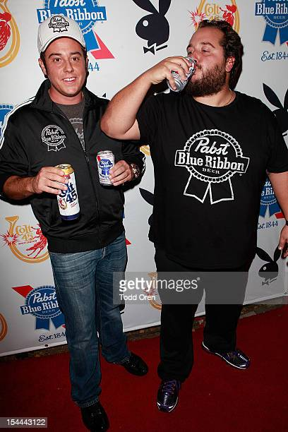 Evan Metropoulos and Daren Metropoulos pose at the Snoop Dogg Presents Colt 45 Works Every Time at The Playboy Mansion Party with Evan and Daren...