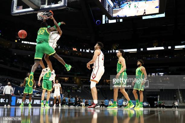 Evan Mobley of the USC Trojans dunks the ball over Franck Kepnang of the Oregon Ducks in the second half of their Sweet Sixteen round game of the...