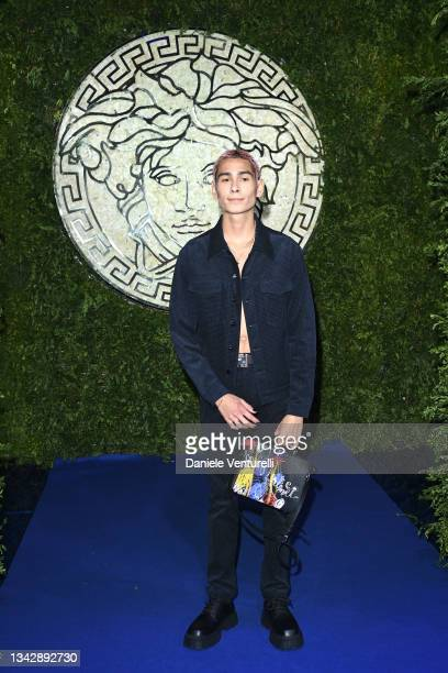 Evan Mock is seen on the front row of the Versace special event during the Milan Fashion Week - Spring / Summer 2022 on September 26, 2021 in Milan,...
