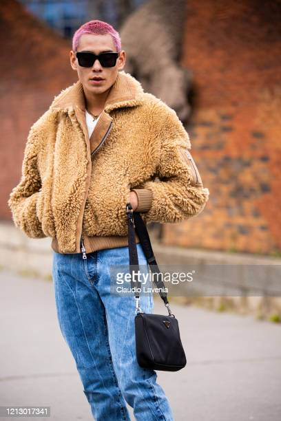Evan Mock wearing a beige fur jacket blue jeans and black Prada bag is seen outside Balmain during Paris Fashion Week Womenswear Fall/Winter...