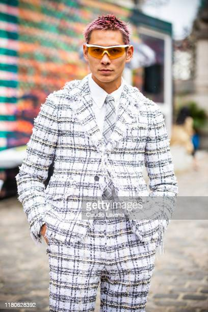 Evan Mock wearing a checked decorated suit is seen outside the Thom Browne show during Paris Fashion Week Womenswear Spring Summer 2020 on September...