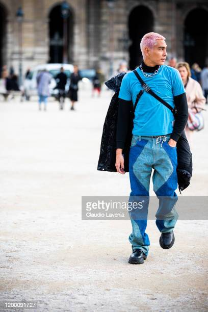 Evan Mock wearing a light blue tshirt decorated jeans and black shoes is seen outside the OffWhite show during the Paris Fashion Week Menswear F/W...