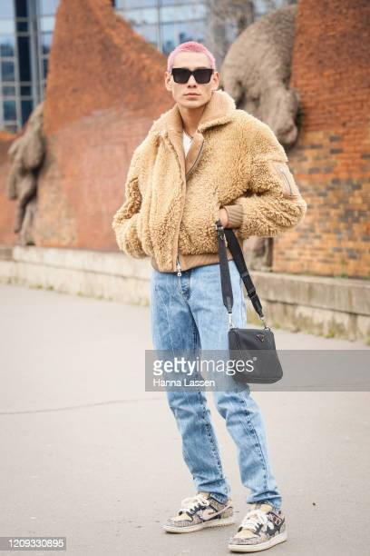 Evan Mock wearing fleece jacket jeans Nike sneakers sunglasses and Prada black bag outside the Balmain show during the Paris Fashion Week Womenswear...