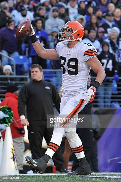 Evan Moore of the Cleveland Browns scores a touchdown against the Baltimore Ravens at MT Bank Stadium on December 24 2011 in Baltimore Maryland The...