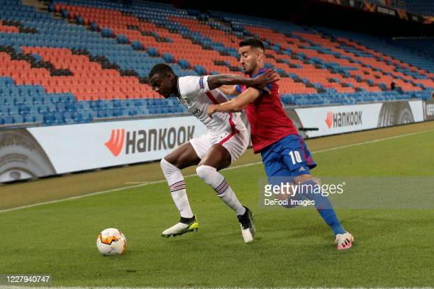 Evan N Dicka of Eintracht Frankfurt and Samuele Campo of FC Basel 1893 battle for the ball during the UEFA Europa League round of 16 second leg match...