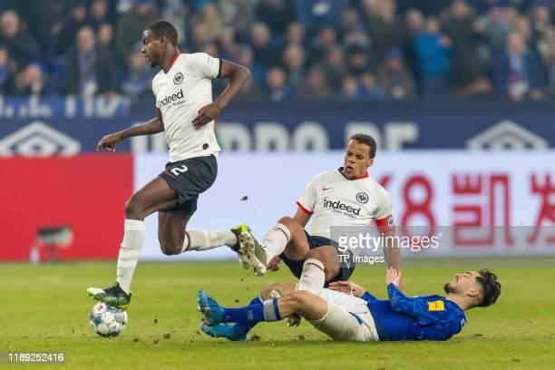 Evan N'Dicka of Eintracht Frankfurt, Timothy Chandler of Eintracht Frankfurt and Suat Serdar of FC Schalke 04 battle for the ball during the...