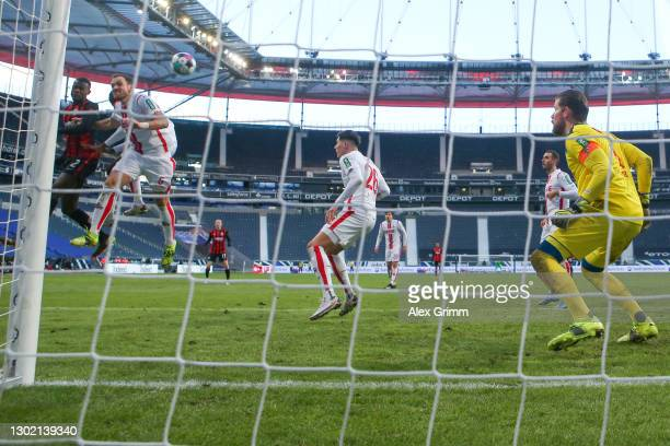 Evan N'Dicka of Frankfurt scores his team's second goal against goalkeeper Timo Horn of Koeln during the Bundesliga match between Eintracht Frankfurt...