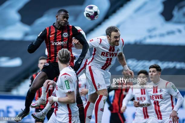 Evan N'Dicka of Frankfurt scores his team's second goal with a header past Tulu Arokodare and Rafael Czichos of Koeln during the Bundesliga match...