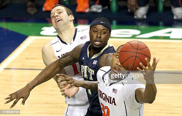 Evan Nolte and Darion Atkins of the Virginia Cavaliers battle for a loose ball against Jamel Artis of the Pittsburgh Panthers during the semifinals...