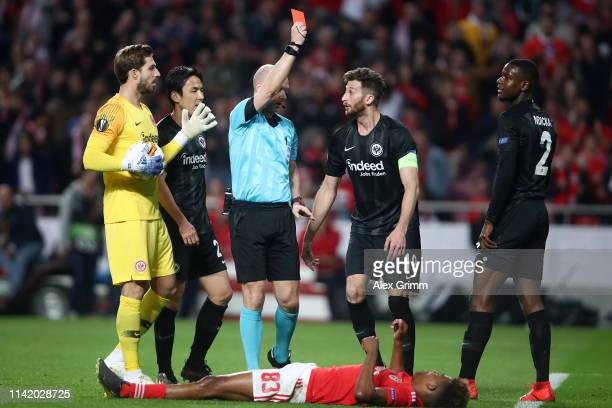 Evan Obite Ndicka of Eintracht Frankfurt is shown a red card by referee Anthony Taylor during the UEFA Europa League Quarter Final First Leg match...