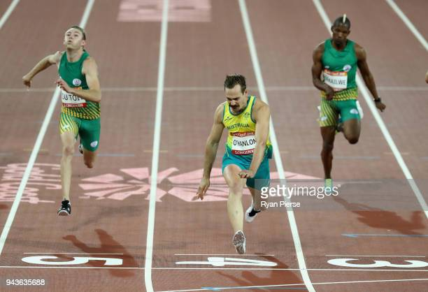 Evan O'Hanlon of Australia crosses the line to win gold ahead of Charl du Toit of South Africa in the Men's T38 100m Final during the Athletics on...