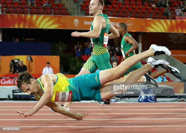 Evan O'Hanlon of Australia falls as he crosses the line to win gold in the Men's T38 100m Final during the Athletics on day five of the Gold Coast...