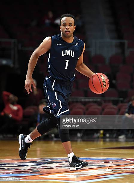 Evan Payne of the Loyola Marymount Lions brings the ball up the court against the Santa Clara Broncos during an openinground game of the West Coast...