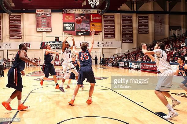Evan Payne of the Loyola Marymount Lions passes the ball to teammate Marin Mornar as Nikolas Skouen and Jett Raines of the Pepperdine Waves defend...