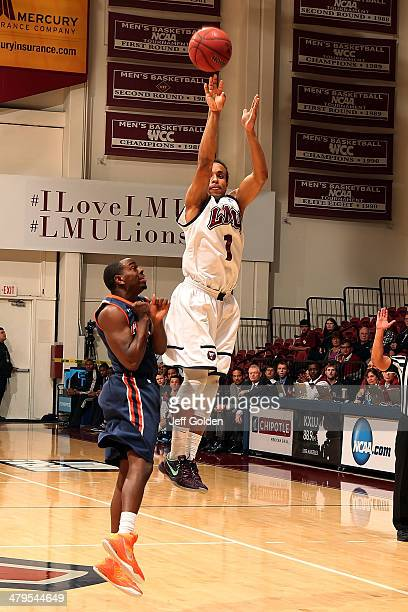 Evan Payne of the Loyola Marymount Lions shoots and makes a threepoint jump shot against Jeremy Major of the Pepperdine Waves with 1357 remaining in...