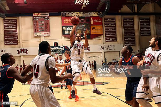 Evan Payne of the Loyola Marymount Lions shoots and makes a layup against the Pepperdine Waves with 1616 remaining in the first half of the game at...