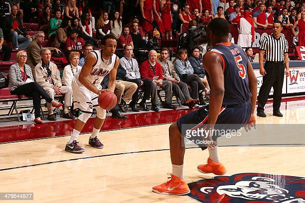 Evan Payne of the Loyola Marymount Lions shoots and misses a threepoint jump shot against Stacy Davis of the Pepperdine Waves with 131 remaining in...