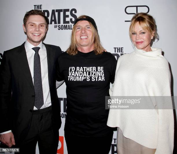 Evan Peters Bryan Buckley and Melanie Griffith attend the premiere of 'The Pirates Of Somalia' at TCL Chinese 6 Theatres on December 6 2017 in...
