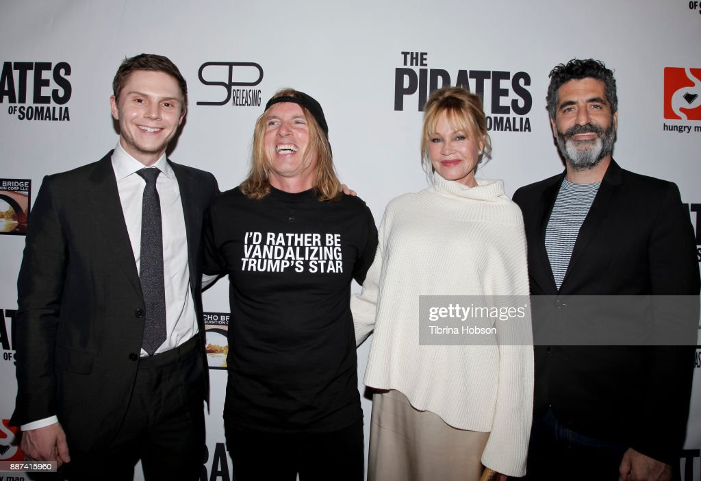 Evan Peters, Bryan Buckley, Melanie Griffith and Mino Jarjoura attend the premiere of 'The Pirates Of Somalia' at TCL Chinese 6 Theatres on December 6, 2017 in Hollywood, California.