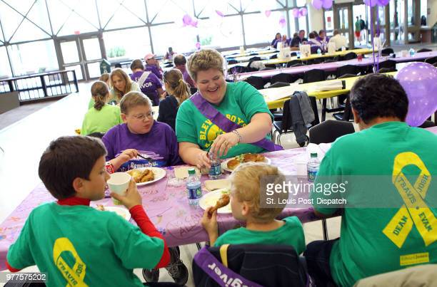 Evan PinaWhite from Eureka and his mother Mary White sit with the rest of their family during the Rockwood School District's American Cancer Society...
