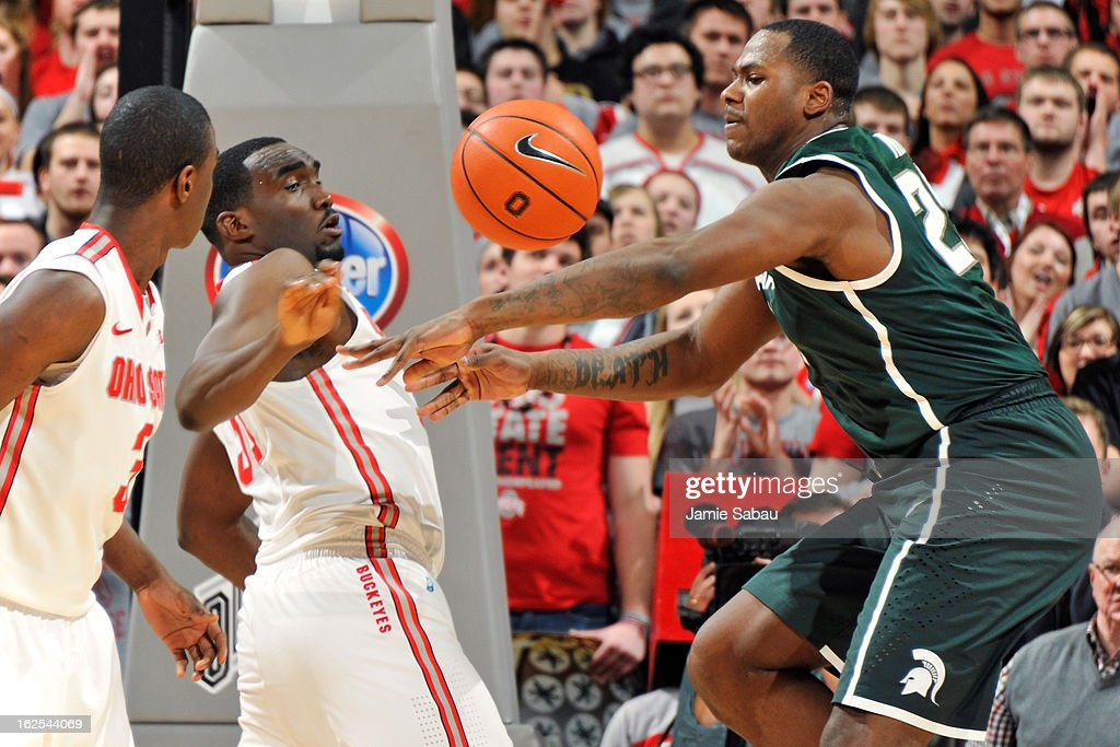 Evan Ravenel #30 of the Ohio State Buckeyes and Derrick Nix #25 of the Michigan State Spartans battle for control of a loose ball in the second half on February 24, 2013 at Value City Arena in Columbus, Ohio. Ohio State defeated Michigan State 68-60.