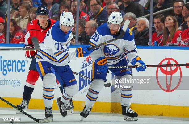 Evan Rodrigues and Scott Wilson of the Buffalo Sabres skate against the Washington Capitals during an NHL game on February 19 2018 at KeyBank Center...