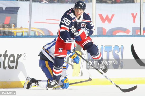 Evan Rodrigues of the Buffalo Sabres and Nick Holden of the New York Rangers colllide during the first period of the 2018 Bridgestone NHL Winter...