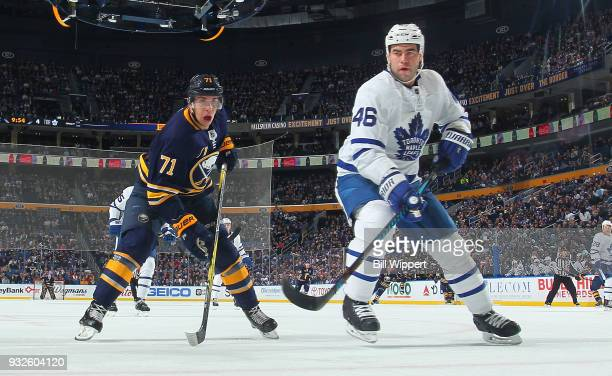 Evan Rodrigues of the Buffalo Sabres and Roman Polak of the Toronto Maple Leafs skate for the puck during an NHL game on March 15 2018 at KeyBank...