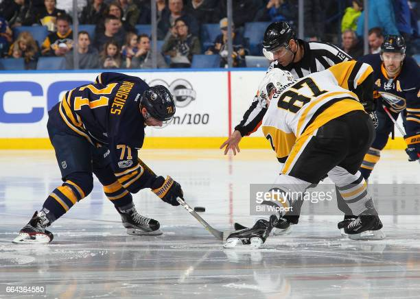 Evan Rodrigues of the Buffalo Sabres and Sidney Crosby of the Pittsburgh Penguins take a faceoff to begin the third period during an NHL game at the...