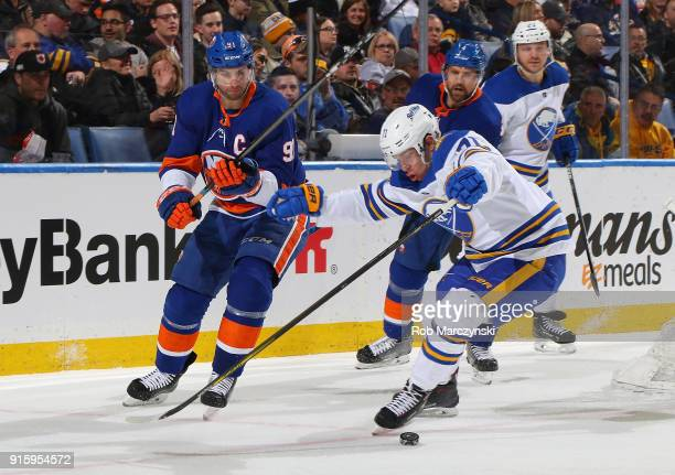 Evan Rodrigues of the Buffalo Sabres battles for the puck with John Tavares of the New York Islanders during the second period of an NHL game on...