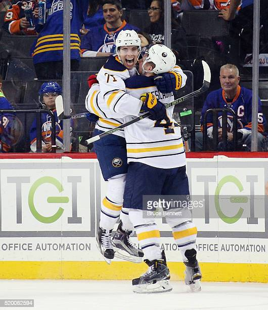 Evan Rodrigues of the Buffalo Sabres celebrates his first NHL goal at 1757 of the second period against the New York Islanders and is embraced by...