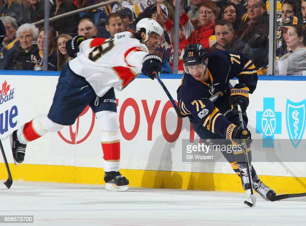 Evan Rodrigues of the Buffalo Sabres gets past Jaromir Jagr of the Florida Panthers during an NHL game at the KeyBank Center on March 27 2017 in...