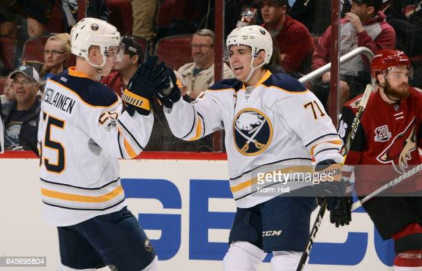 Evan Rodrigues of the Buffalo Sabres is congratulated by teammate Rasmus Ristolainen after scoring a second period goal against the Arizona Coyotes...