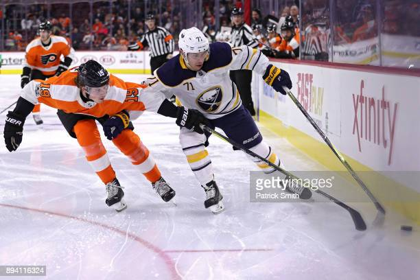 Evan Rodrigues of the Buffalo Sabres skates past Nolan Patrick of the Philadelphia Flyers during the first period at Wells Fargo Center on December...